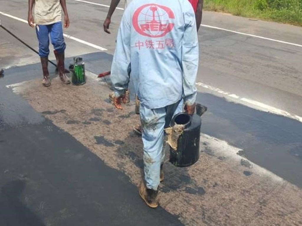 Workers undergoing Crack Sealing on Road