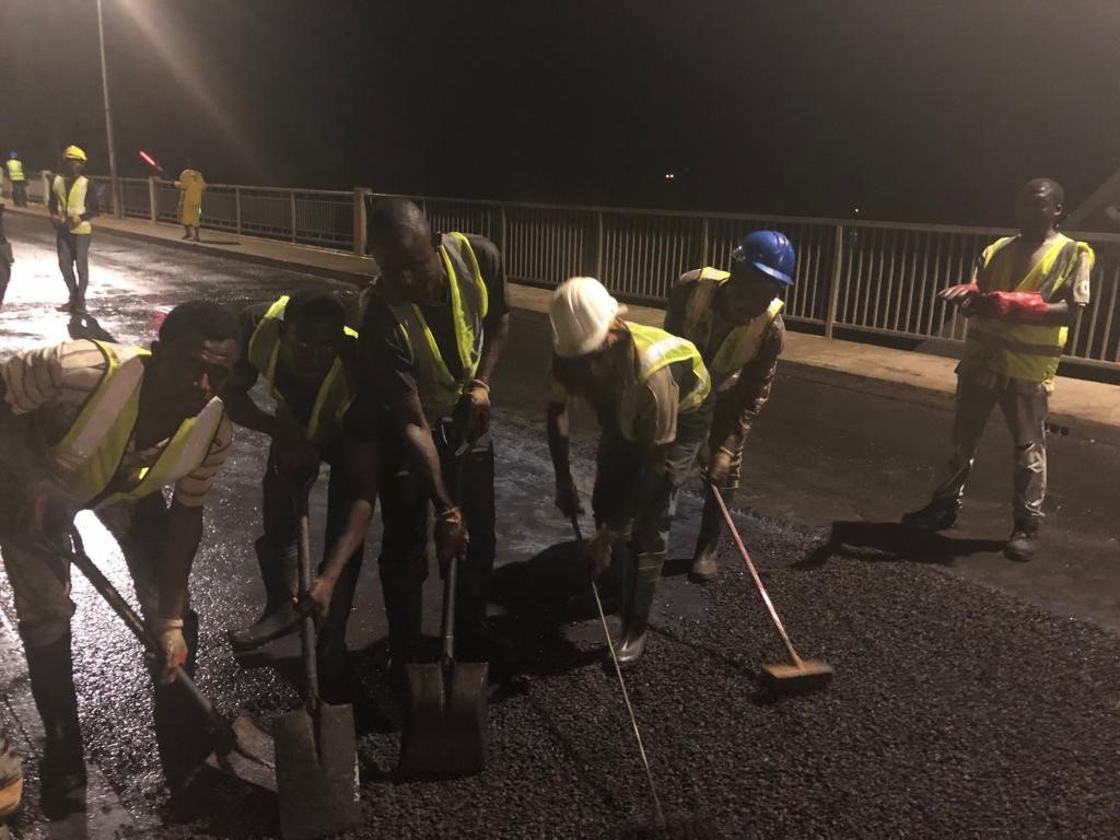 Workers undergoing Resurfacing on Bridge Deck